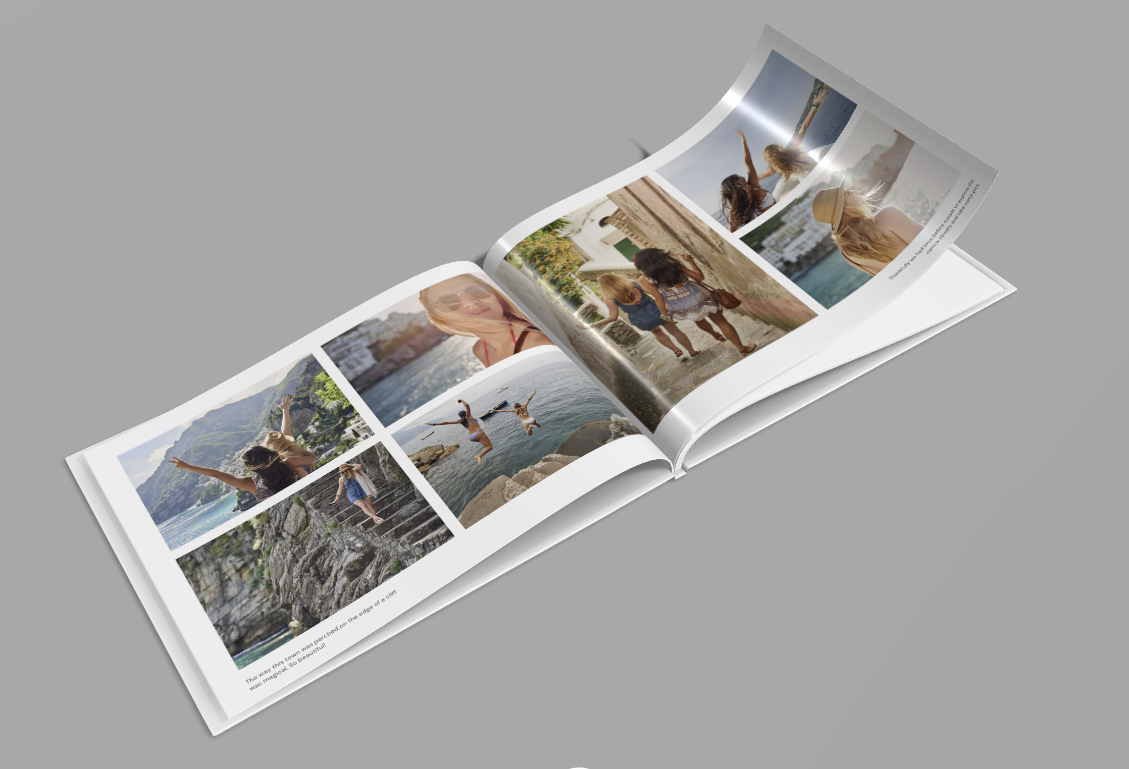 A three-dimentional rendering of a photobook opened in the middle on a grey background